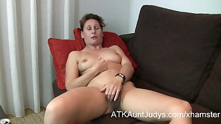 47-year old coy Milf Inge spreads her legs